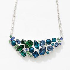 "Sapphire, Peridot, Indicolite, Denim Blue, Dark Moss Green, Erinite, Montana, and Emerald crystal; Petrol crystal pearl; rhodium plating; 16"" to 19"".  Lobster clasp closure."