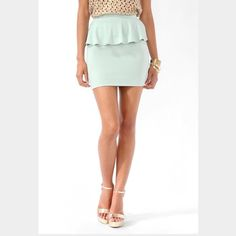 Mint Green Ponte Knit Peplum Skirt The color is a muted mint green. The peplum is perfect for covering up that little pooch always a problem for me! 88% polyester 9% rayon 3% spandex. Never got the chance to wear, brand new with tags. Skirts Pencil