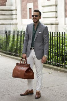 Grey tortoise shades by Matsuda, Light grey wool suit jacket by Michael Andrews Bespoke (Cloth by Ariston #AR A866/8), Teal linen shirt by Ermenegildo Zegna, Brown suede D-ring belt by Brooks Brothers, White denim jeans by Helmut Lang, Custom crocodile skin loafers by Scarpe di Bianco, American Alligator duffle bag handmade by Frank Clegg Leatherworks