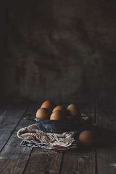 Light. The low light makes me think of a farmer doing early morning chores, maybe gathering eggs for breakfast. Fresh and yummy! /