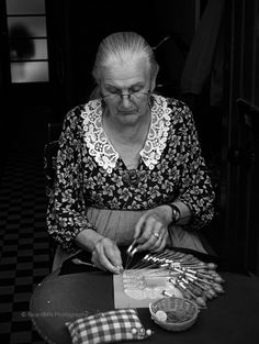 A lacemaker in Bruges, the capital and largest city of the province of West Flanders in the Flemish Region of Belgium. It is located in the northwest of the country. The Bobbin Lace, is a speciality of Bruges. In the fifteenth century Charles the Fifth decreed that lace making was to be taught in the schools and convents of the Belgian provinces. During this period of renaissance and enlightenment, the making of lace was firmly based within the domain of fashion.