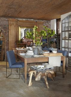 Another selectionof Jayson Home's furniture and home accessories, including an Antique Suede Top Desk and small Teak Root Table.