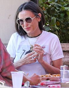 Just for women: Demi Moore showed off her greying hair as she enjoyed a meal with a female...
