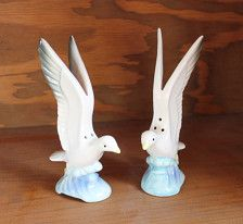 This pair of vintage seagull salt and pepper shakers is sure to brighten up any kitchen!  They are in very good vintage condition. Look to have never been used as shakers. No chips or cracks.  They stand about 5.5 inches tall. Both have their stoppers. I am most certain they are from Japan.  Great for a nautical themed home or beach house!  Thank you for visiting my store.
