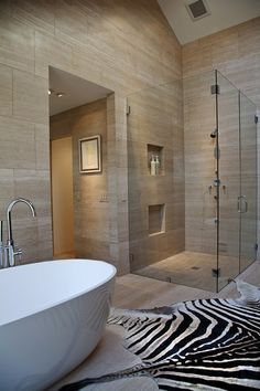 Tall ceilings modern bath/shower. Lose the dead zebra.