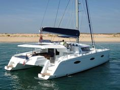 Luxury Catamaran Fountaine Pajot Sanya 57 is m long and it has 5 cabins and 10 berths. It's available for charter in France, Italy and Spain. Sailing Catamaran, Yacht Boat, Sailing Ships, Pontoon Houseboat, Liveaboard Boats, Sanya, Speed Boats, Motor Boats, Luxury Yachts