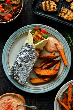 Vegetarian harissa marinated halloumi cheese flatbreads with roasted vegetables and spiced sweet potato wedges
