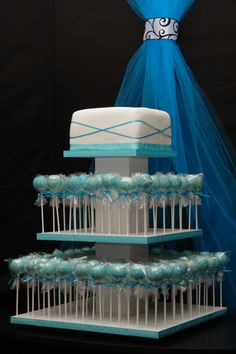 Not too crazy about the colours or the wrappings on the cake pops, but love the idea of a real cake to cut on top of the cake pop display