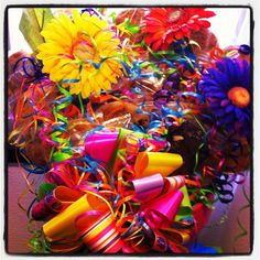 Four dozen cookie bouquet with silk flowers added for a spring party