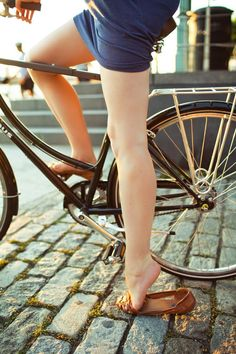 A CUP OF JO: Riding bikes while wearing skirts