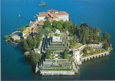 There is an island in Stresa Italy called Isola Bella where white peacocks roam and lotus plants grow.     This island is apart of three that were once owned by the Borromean family between the 16th and 17th century. Now visitors can go to all three and take in their beauty.