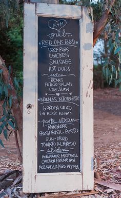 Outdoor menu...old door and chalkboard paint.  Easy enough for us to do! | CatchMyParty.com