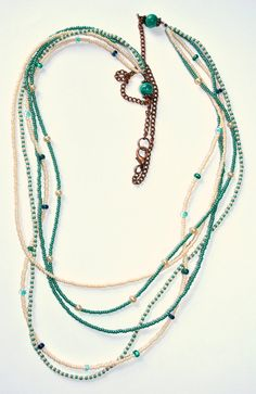 Sea Blue-Green and Pearl White Long Seed Bead Necklace. $20.00, via Etsy.