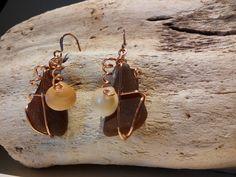 Brown sea glass with copper ear wire with non-tarnish copper wire. Small shell embellishment. SGE14 $25