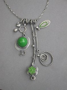 grass green double pendant. by jamie jo fisher via Etsy.