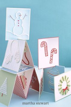 Luckily for yarn-card enthusiasts, the winter holidays offer plenty of symbols to play with: wreaths, snowmen, fir trees, snowflakes, mittens, candy canes, and more. Experiment with yarn in different colors, weights, and textures, even on the same card. #marthastewart #christmas #diychristmas #diy #diycrafts #crafts