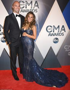Bump in the night: Jana Kramer shows off her pregnant belly as she poses with Mike Caussin