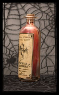 Pre-Made Witches Apothecary Bottle - Phoenix Feathers. $10.00, via Etsy.