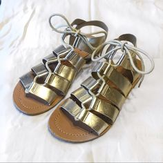 Metallic Gold Gladiator Lace Up Sandals Cute lace up gladiator sandals in a light metallic gold color on faux leather! Super cute!!  Madden Girl Shoes Sandals
