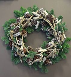 Christmas door wreath designed by Cemal Cemal at Phillo Flowers in London, using pine cones, driftwood, cinnamon sticks and pine leaves
