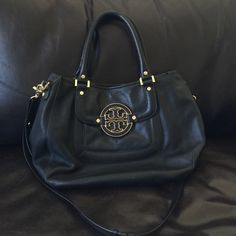 """Tory Burch Amanda Hobo Italian Leather, plenty of interior pockets magnetic snap closure, exterior back slit pocket, tubular leather handle, removals adjustable crossbody strap measuring 24"""" at longest. Height 11"""" Length 14"""" Depth 4.5"""" No scratches/inside of bag very clean/ no stains/ non-smoking environment ...reason I'm selling: I am too short and cross body is long for me Tory Burch Bags Crossbody Bags"""