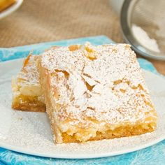 This sticky, chewy, delicious treat is a St. Louis tradition and can be found in every bakery and grocery store around the city. This treat has quickly become a Midwestern tradition as well and can… Peanut Butter Slice, Ooey Gooey Butter Cake, Köstliche Desserts, Delicious Desserts, Yummy Food, Healthy Food, Sweet Recipes, Cake Recipes, Plate