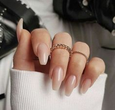 "If you're unfamiliar with nail trends and you hear the words ""coffin nails,"" what comes to mind? It's not nails with coffins drawn on them. It's long nails with a square tip, and the look has. Blush Nails, Nude Nails, Glitter Nails, White Nails, Pink Glitter, Neutral Gel Nails, Nail Gradient, Solid Color Nails, Fall Acrylic Nails"