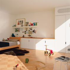 child's room with storage, light, and floor space = ah bliss