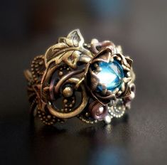 .Gorgeous ring with leaves and a blue crystal...pinned by ♥ wootandhammy.com, thoughtful jewelry.