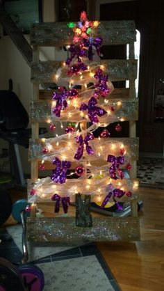 Pallet lighted Christmas tree in purple for dementia awareness.  www.facebook.com/joolzcustomdesign