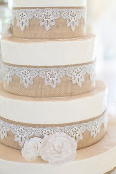 Burlap and Lace Wedding Cake - love the lace and flowers!!!- would change flowers to brown lace