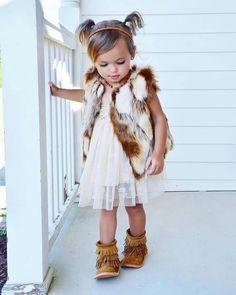 Fur vest, lace dress, suede booties.