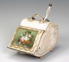 A VICTORIAN CREAM PAINTED AND PARCEL GILT COAL SCUTTLE WITH A REVERSE PAINTED GLASS PLAQUE MOUNTED IN THE LID,  LATE 19TH CENTURY,http://www.christies.com/
