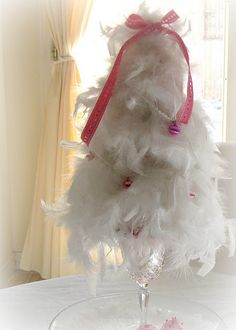 Feather boa tree - uh yes could use bright colors for peacock wedding to decorate with