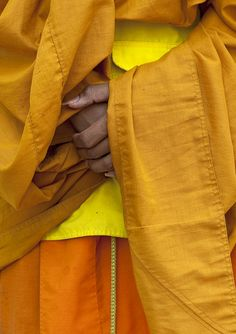 Buddhist monk's hands, Laos, 2009, photograph by Eric Lafforgue.