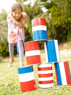 Partygoers will have a blast with this July Fourth carnival game, crafted from tin cans.