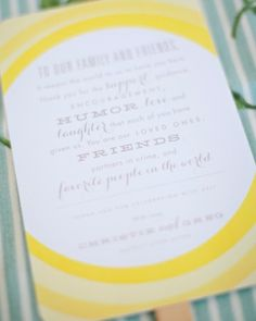 Ceremony proceedings were outlined on cheery yellow fans. A thank-you note to all of their guests was written on the backs