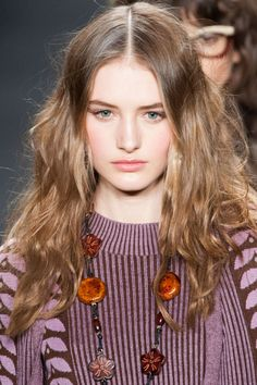 """Hairstylists, it seems, collectively bought into the """"if it ain't broke..."""" motto, because spring's prettiest, simplest trend—bohemian waves in long hair—is being carried over into fall. The focus is on thick texture and kinky movement (like at Anna Sui, left) that looks like you simply braided damp hair, let it air-dry, then unwound to effortless perfection."""