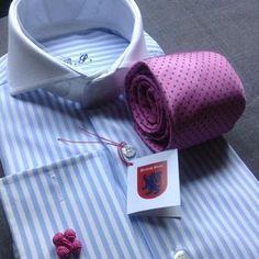 Blue stripe shirt with white cutaway contrasting collar, light purple tie