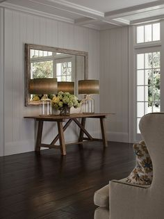 Vertical siding, table ad lamps.