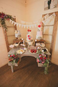 Dessert Buffet Surrounded By Rustic Flowers, Banner, & Windows