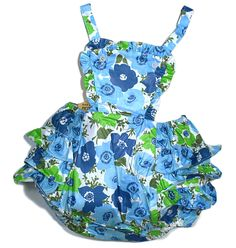 Vintage Toddler's playsuit and/or swimsuit. Fun in the sun romper with bib front. Polished glazed cotton in a gorgeous flower print. Ruffles...