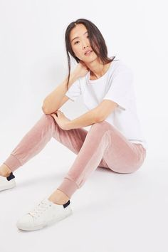 The early noughties' favourite style comes updated with these blush joggers in luxe velour. In a slim fit, they feature pockets, an elasticated waist and ribbon ties at the waist. Wear with a plain t-shirt and trainers for a casual day-to-day feel.