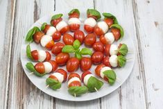 Simple recipe for tomato, mozzarella and basil skewers. Perfect for a tapas dinner, brunch or maybe as a snack. Superfood, Veggie Recipes, Vegetarian Recipes, Veggie Food, Tapas Dinner, Fruit Creations, Party Food Platters, Charcuterie And Cheese Board, Charcuterie Ideas