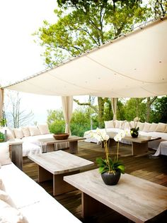 This covered patio would be even more elegant and private with some gauzy curtains surrounding the tent!