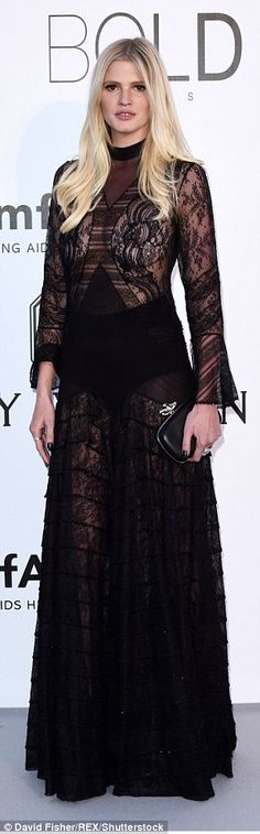 Racy as ever: Lara took things from the front of the camera to the red carpet as she shocked in an entirely sheer gown, with the model bravely choosing to completely forgo her bra for the occasion