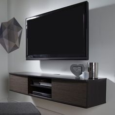 South Shore Agora Wall-Mounted TV Stand For TVs up to Multiple Finishes Console hangs on wall, so floor is less cluttered. Fits a flat panel TV up to Fastening device for hanging TV on wall and other accessories not included.