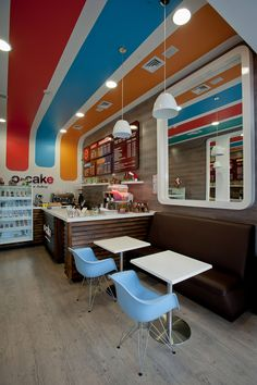 Bright colors, glossy whites, natural materials: O CAKE American bakery by Plasma, Medellín   Colombia