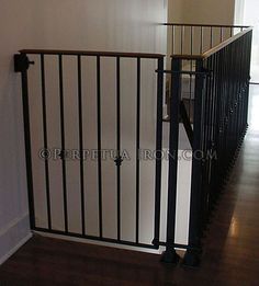 Wonderful View Of A Custom Decorative Iron Baby Gate Made To Fit The Top Of Stairs.  The Design Is Integrated Into The Existing Handrail That Wraps Around An  Open ...