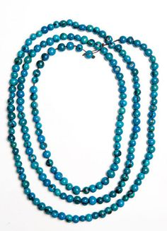 Brightly Colored Acai Rope Necklace (Turquoise) | Acai beads strung together by artisans in Ecuador.  It takes 3 months for the seed to become a bead!  The artisans have been able to rise out of poverty and now employ other community members.